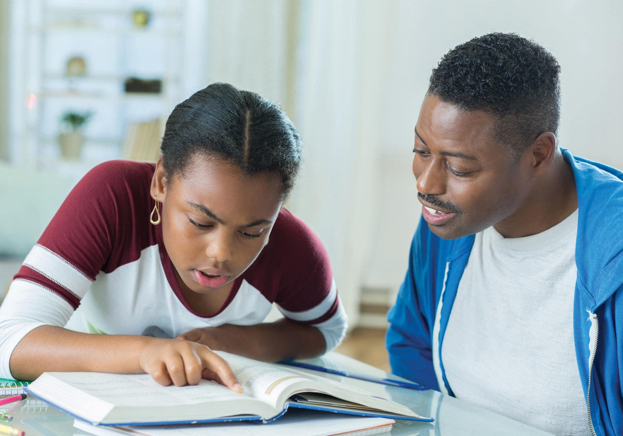 Dad helping teenage daughter with homework