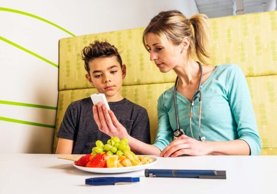 doctor meeting with diabetic boy